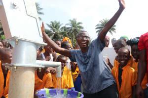 The Water Project: Lokomasama, Gbonkogbonko, Kankalay Primary School -  Head Teacher Celebrates At The Well