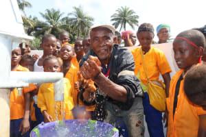 The Water Project: Lokomasama, Gbonkogbonko, Kankalay Primary School -  Headman Playing With Water