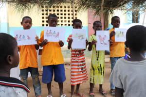 The Water Project: Lokomasama, Gbonkogbonko, Kankalay Primary School -  Students Hold Up Posters