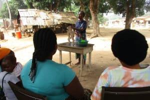 The Water Project: Lungi, Mahera, Mahera Health Clinic -  Hygiene Facilitator Teaching About Diarrhea