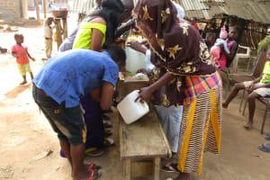 The Water Project: Lungi, Mahera, Mahera Health Clinic -  Participants Constructing Tippy Tap