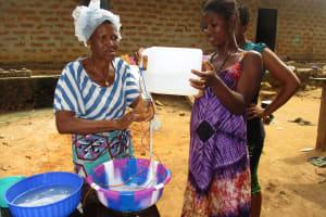 The Water Project: Lungi, Mahera, Mahera Health Clinic -  Participants Demonstrating Handwashing