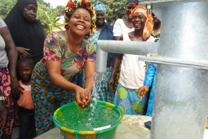 The Water Project: Lungi, Mahera, Mahera Health Clinic -  Woman Joyfully Playing