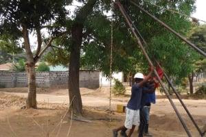 The Water Project: Lungi, Mahera, Mahera Health Clinic -  Setting Up Tripod