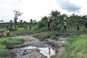 The Water Project: Alero B Community -  Carrying Water Home