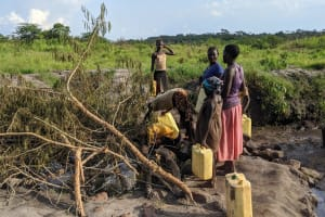 The Water Project: Alero B Community -  Community Members At The Scoop Hole