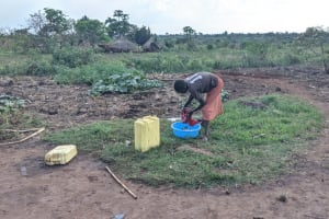 The Water Project: Alero B Community -  Marion Apeyo Wahing Clothes