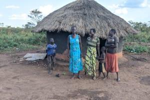 The Water Project: Alero B Community -  Santa Biriyema With Children And Neighbors