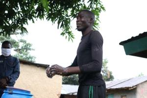 The Water Project: Itukhula Community, Lipala Spring -  A Community Member Demonstrating Handwashing