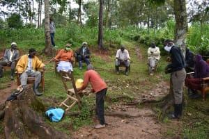 The Water Project: Maganyi Community, Bebei Spring -  A Boy Demonstrating Handwashing