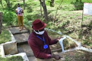 The Water Project: Ingavira Community, Laban Mwanzo Spring -  Demonstration On Making Masks
