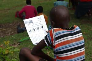 The Water Project: Sambaka Community, Sambaka Spring -  Reading Through Kiswahili Informational Pamphlet