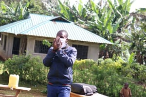 The Water Project: Eluhobe Community, Amadi Spring -  Do Not Cough Into Your Hands Like This