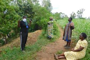 The Water Project: Mungakha Community, Nyanje Spring -  Team Leader Emmah Leads Training