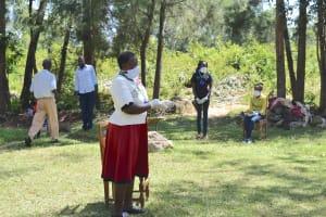 The Water Project: Munenga Community, Burudi Spring -  Team Leader Emmah In Full Ppe At Training