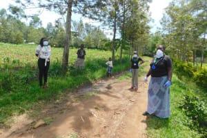 The Water Project: Eshiakhulo Community, Asman Sumba Spring -  Facilitators In Full Protective Gear At Training