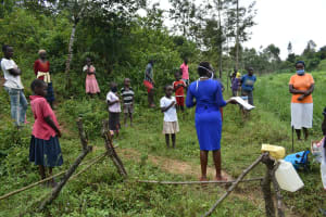 The Water Project: Mukoko Community, Mshimuli Spring -  Trainer Mary Leading The Training