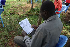 The Water Project: Elukuto Community, Isa Spring -  Use Of Handouts In The Training