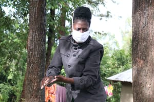 The Water Project: Lutali Community, Lukoye Spring -  The Faciliator During Handwashing Demonstration