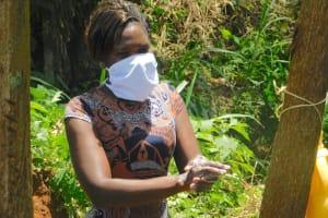 The Water Project: Mungakha Community, Asena Spring -  Lynah Demonstrates Handwashing