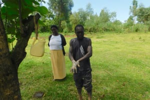 The Water Project: Ataku Community, Ngache Spring -  Leaky Tin Handwashing Demonstration