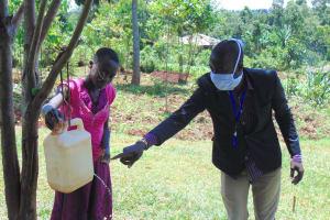 The Water Project: Visiru Community, Kitinga Spring -  Handwashing With Leaky Tin Demonstration