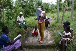 The Water Project: Ingavira Community, Laban Mwanzo Spring -  Trainer Emphasizes A Point