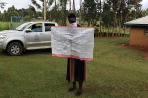 The Water Project: Elukuto Community, Isa Spring -  Use Of Reminder Chart At The Training