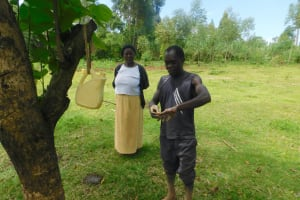 The Water Project: Ataku Community, Ngache Spring -  Getting Under The Fingernails Is Important