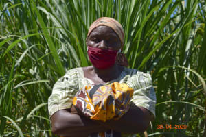 The Water Project: Emulembo Community, Gideon Spring -  Portrait Of A Community Member With Her Mask