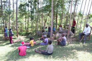 The Water Project: Shirugu Community, Shapaya Mavonga Spring -  Team Leader Catherine Chepkemoi Encouraging Community To Follow National Guidelines