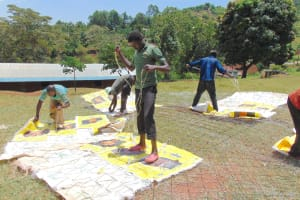 The Water Project: Kapsaoi Primary School -  Sewing Suger Sacks To Dome Wire