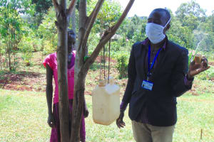 The Water Project: Visiru Community, Kitinga Spring -  Explaining Benefits Of Soap