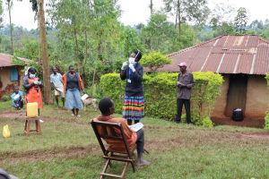 The Water Project: Wanzuma Community, Wanzuma Spring -  Training On Proper Way To Wear A Mask