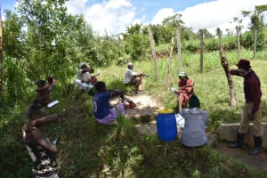 The Water Project: Ingavira Community, Laban Mwanzo Spring -  Sneezing Into The Elbow Prevents Virus Spread