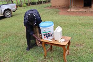 The Water Project: Elukuto Community, Isa Spring -  Using Local Materials To Make Handwashing Stations