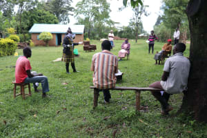 The Water Project: Malava Community, Ndevera Spring -  Trainer Kayi Taking The Group Through Training