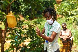 The Water Project: Shikhombero Community, Atondola Spring -  Betty Leads Handwashing Demonstration