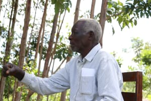The Water Project: Shirugu Community, Shapaya Mavonga Spring -  Mr Shapaya Asking About The Fist Bump Greeting Which Is Not Advised Now