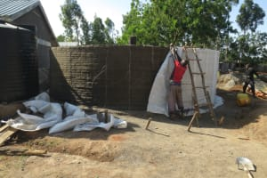 The Water Project: St. Gerald Mayuge Secondary School -  Removing Sacks Reveals Interior Cement