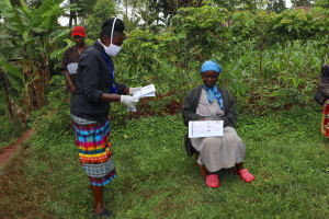 The Water Project: Wanzuma Community, Wanzuma Spring -  Issuing Participants With Pamphlets