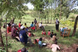 The Water Project: Sambaka Community, Sambaka Spring -  Trainer Karen Leading The Session
