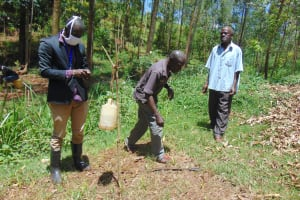 The Water Project: Visiru Community, Kitinga Spring -  Installing A Leaky Tin For Handwashing At The Spring