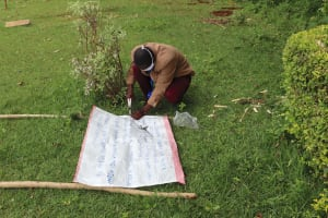 The Water Project: Lugango Community, Lugango Spring -  Improvising Stand For Caution Chart