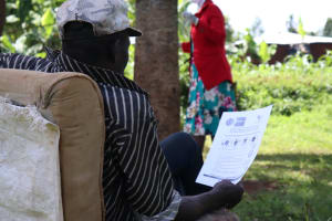 The Water Project: Asimuli Community, John Omusembi Spring -  Use Of Handouts At The Training