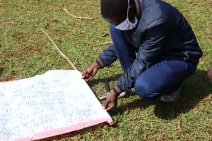 The Water Project: Eluhobe Community, Amadi Spring -  Sir Samuel Pinning The Chart To The Poles