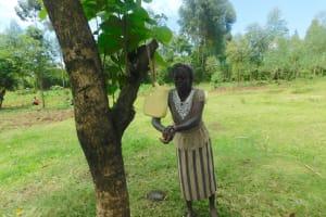 The Water Project: Ataku Community, Ngache Spring -  Irine Chair Of Water Committee Handwashing