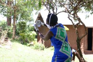 The Water Project: Shirugu Community, Shapaya Mavonga Spring -  Facilitator Explaining How To Make A Cloth Face Mask
