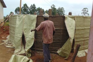 The Water Project: Jinjini Friends Primary School -  Extraction Of Sacks From Plastered Wall