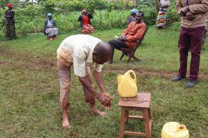The Water Project: Wanzuma Community, Wanzuma Spring -  A Community Member Demonstrates Handwashing At The Training